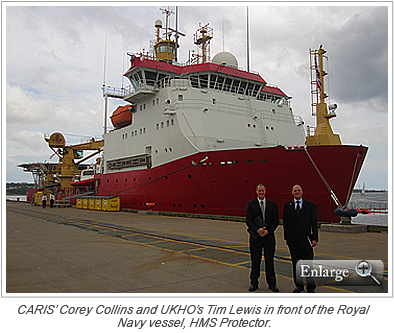 CARIS' Corey Collins and UKHO's Tim Lewis in front of the Royal Navy vessel, HMS Protector.