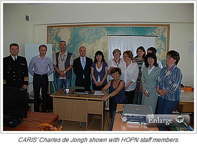 CARIS' Charles de Jongh shown with HOPN staff members.