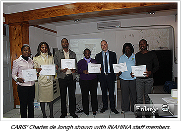 CARIS' Charles de Jongh shown with INAHINA staff members.
