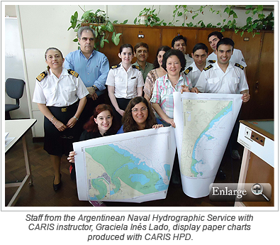 Staff from the Argentinean Naval Hydrographic Service with CARIS instructor, Graciela Inés Lado, display paper charts produced with CARIS HPD.