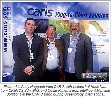 Pictured is Andy Hoggarth from CARIS with stand visitors Lai Hock Nam from OKENOS Sdn. Bhd. and Cesar Pimenta from Intelligent Maritime Solutions at the CARIS stand during Oceanology International.