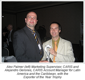 Alex Palmer (left) Marketing Supervisor, CARIS and Alejandro Gerones, CARIS Account Manager for Latin America and the Caribbean, with the Exporter of the Year Trophy