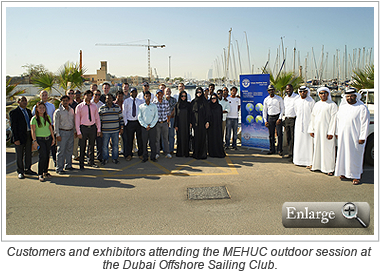 Customers and exhibitors attending the MEHUC outdoor session at the Dubai Offshore Sailing Club.