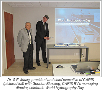 Dr. S.E. Masry, president and chief executive of CARIS (pictured left) with Geerten Blessing, CARIS BV's managing director, celebrate World Hydrography Day.